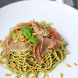 green spaghetti with prosciutto and pine nuts