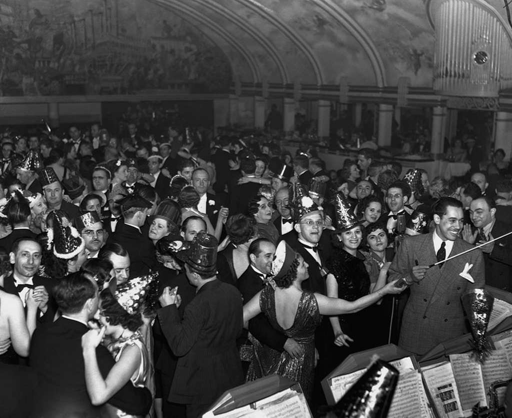 American bandleader and singer Cab Calloway leads an orchestra during a New Year's Ball at the Cotton Club in New York, 1937.