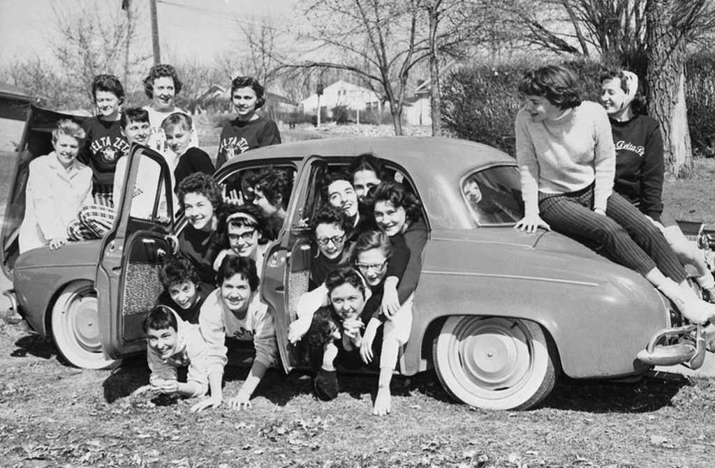Sorority sisters fro Alpha Delta Pi and Delta Zeta pack into a tiny Renault to try and set a record of 27 women in a car. Car packing was a fad that swept across America in the late 1950s and early 1960s.
