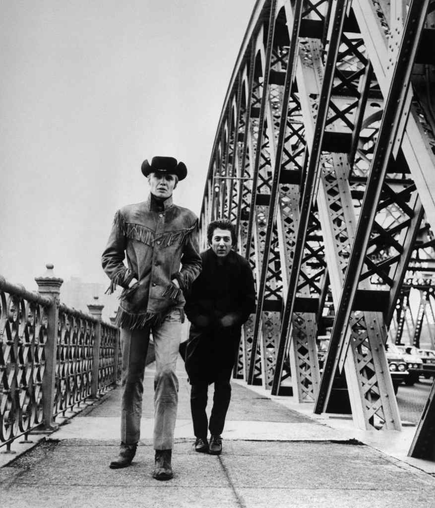 "Original Caption: 12/28/1968-Hoffman and the ""Midnight Cowboy"" Jon Voight cross New York's Willis Avenue Bridge in a scene from the film, the story of two men who discover friendship."